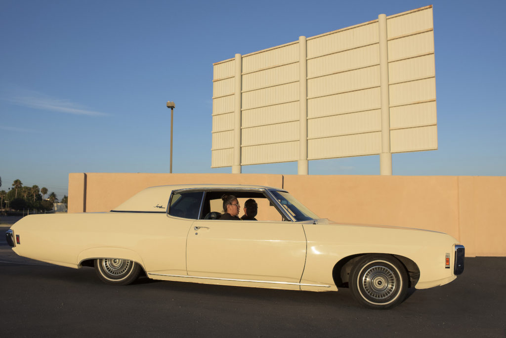 A side-on view of a white low-rider