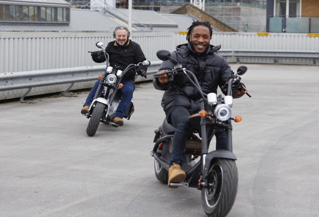 Tee and Robert Grace ride their own eco bikes