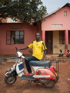 A man posing with his Vespa T5