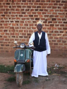 A member of the Muslim community with his Vespa