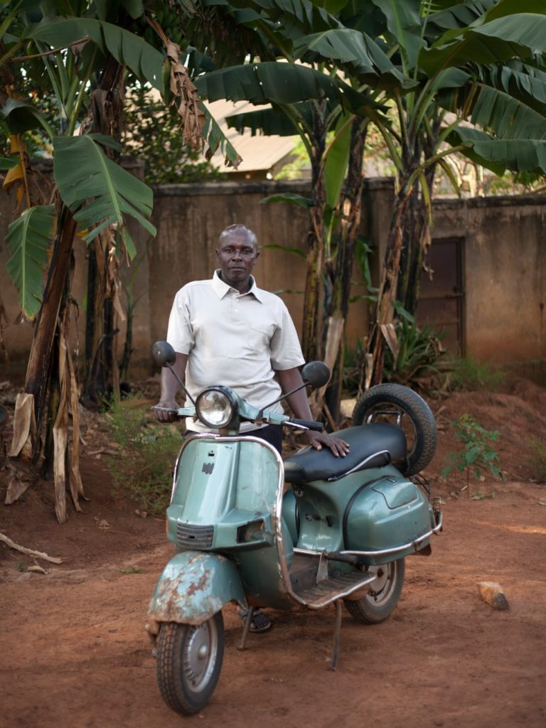 A green Vespa shines in Africa.