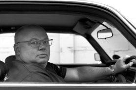 Charles Evans behind the wheel