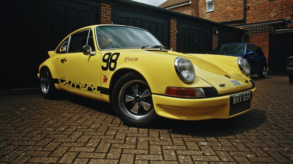 A partial side view of the Porsche