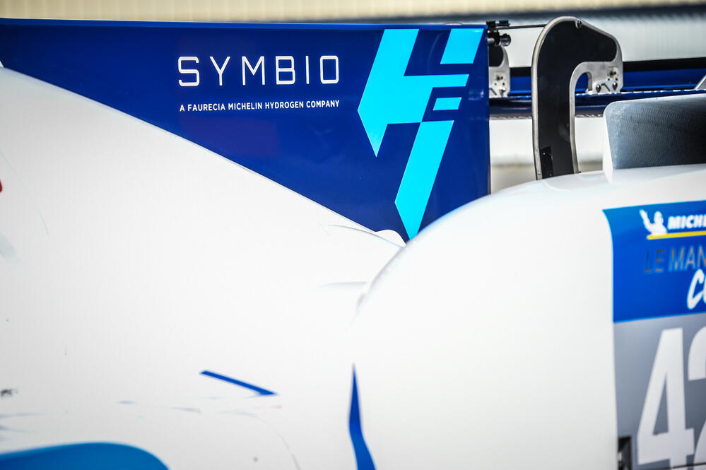 The Symbio logo on the side of the race car